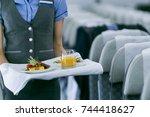 flight attendant serving | Shutterstock . vector #744418627