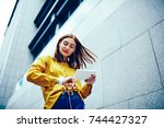 charming creative female... | Shutterstock . vector #744427327
