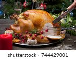 carving rustic style roasted... | Shutterstock . vector #744429001