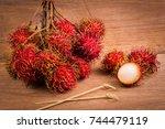 rambutan put together on a... | Shutterstock . vector #744479119