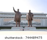 Small photo of PYONGYANG, NORTH KOREA (DPRK) - SEPTEMBER 14, 2017: Grand Monument Mansudae. Statues of Great Leaders Kim Il Sung and Kim Jong Il against a background of mosaic with a sacred mountain Paektusan