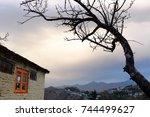 Quaint Cottage And A Barren...