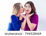 two beautiful girls emotionally ... | Shutterstock . vector #744528469