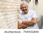 mature man smiling at camera in ... | Shutterstock . vector #744531844