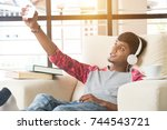 indian teenage male sitting on... | Shutterstock . vector #744543721