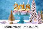 happy new year 2018 cupcakes on ... | Shutterstock . vector #744550291