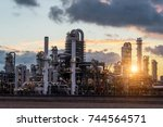 oil refinery at sunset in... | Shutterstock . vector #744564571