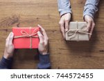 gives a gift christmas and new... | Shutterstock . vector #744572455