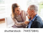 health visitor and a senior man ... | Shutterstock . vector #744573841