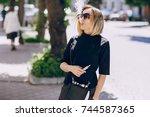 young beautiful girl enjoys...   Shutterstock . vector #744587365