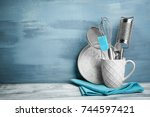 kitchen utensils in cup on... | Shutterstock . vector #744597421