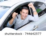 happy man with key sitting in... | Shutterstock . vector #744642577