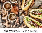 beer and hot dogs. concept of... | Shutterstock . vector #744643891