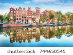 traditional dutch old houses on ... | Shutterstock . vector #744650545