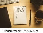 top view of notepad with goals... | Shutterstock . vector #744660025