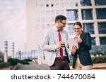 happy business people working... | Shutterstock . vector #744670084