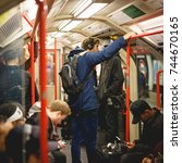 Small photo of London, UK - October 2017. People commuting on an underground train in London. The Tube handles up to 5 Million passenger per day. At peak times, more than 543 trains whiz around the Capital.