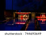 court for bowling in a dark room | Shutterstock . vector #744693649