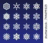 separate snowflakes doodles... | Shutterstock .eps vector #744699325
