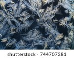 ice crystals  on the window  | Shutterstock . vector #744707281