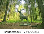 wooden sculpture of a deer in... | Shutterstock . vector #744708211