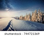 starry sky in winter snowy... | Shutterstock . vector #744721369