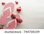 red and white flip flops and... | Shutterstock . vector #744730159