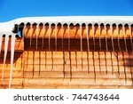 icicles on roof in winter day ...   Shutterstock . vector #744743644