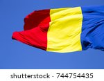 romanian flag on the mast.... | Shutterstock . vector #744754435