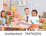 cute children painting with... | Shutterstock . vector #744762241