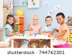 cute children painting at table ... | Shutterstock . vector #744762301