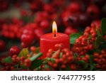 christmas candles in red.... | Shutterstock . vector #744777955