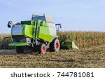 combine harvester in action... | Shutterstock . vector #744781081