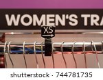 Small photo of silver shop hanger for clothes with visible XS size label.