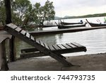 old wooden chair placed beside... | Shutterstock . vector #744793735