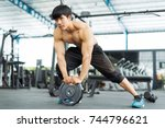 fitness man in training showing ... | Shutterstock . vector #744796621