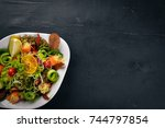 salad with salted salmon ... | Shutterstock . vector #744797854