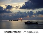 silhouette of offshore drilling ... | Shutterstock . vector #744803311