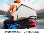 delivery man ride motorcycle... | Shutterstock . vector #744808339