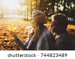 portrait of couple in autumn on ... | Shutterstock . vector #744823489
