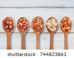 five wooden spoons with... | Shutterstock . vector #744823861