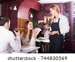 happy russian  waitress serving ... | Shutterstock . vector #744830569