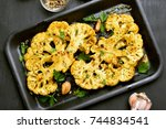 baked cauliflower steaks with... | Shutterstock . vector #744834541
