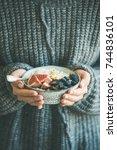healthy winter breakfast. woman ... | Shutterstock . vector #744836101