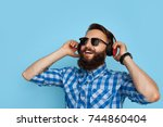 young hipster man in checkered... | Shutterstock . vector #744860404