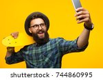 young bearded man in glasses... | Shutterstock . vector #744860995