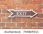 exit sign on wall. | Shutterstock . vector #744869311