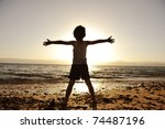 Silhouette Of Child On The...