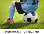 child sitting on soccer ball.... | Shutterstock . vector #744878785