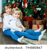 two sisters sitting on the... | Shutterstock . vector #744880867